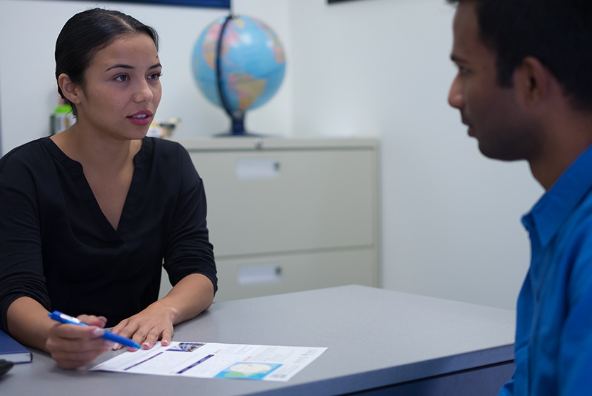 A counselor talking to a student