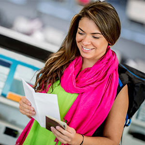 woman looking at passport