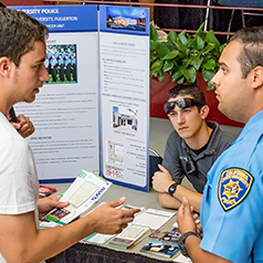Students speaking about campus safety with University Police