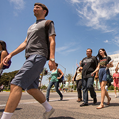 View of many students walking to and from classes on one of paths at CSUF