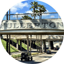 View of bridge in Fullerton above streets that reads 'FULLERTON'
