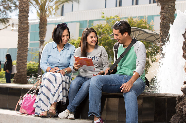 Students chatting by the fountain area