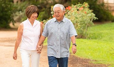 senior citizens walking in park