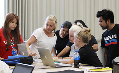 International graphic design students in Mac computer lab