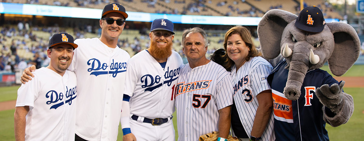 President Fram Virjee posing with the Dodgers
